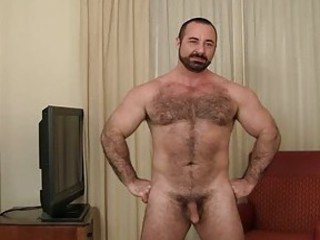 Bearded gay bear strips in his living room / 733